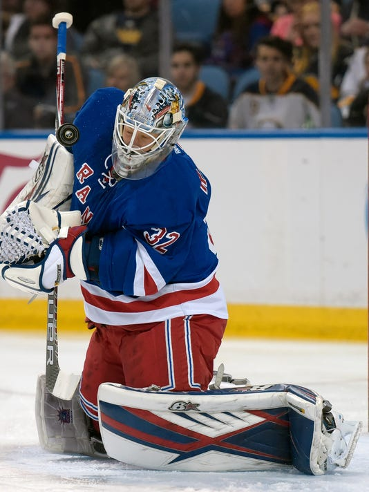 New York Rangers goaltender Antti Raanta, of Finland, makes a blocker save during the first period of an NHL hockey game against the Buffalo Sabres, Tuesday, March 8, 2016, in Buffalo, N.Y. (AP Photo/Gary Wiepert)