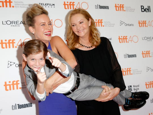 Joan Allen, right, smiles with Jacob Tremblay and Brie