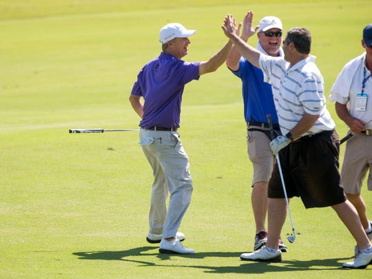 David Toms is all smiles after a fellow golfer sinks a long putt during the Chubb Classic Pro-Am at TwinEagles Club Wednesday, Feb. 15, 2017 in Naples.