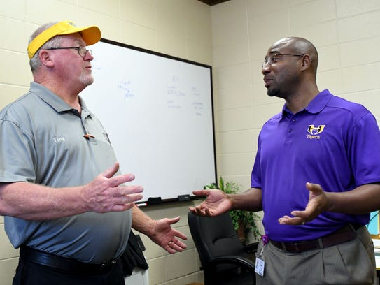 Robert Williams, right , speaks with maintenance supervisor Tony Stanley at the HPSD Maintenance Department. Williams recently completed his first year as superintendent of Hattiesburg Public School District.