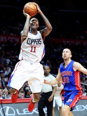 The Los Angeles Clippers' Jamal Crawford makes a basket over the Detroit Pistons' Steve Blake, right, at Staples Center in Los Angeles on Saturday, Nov. 14, 2015.