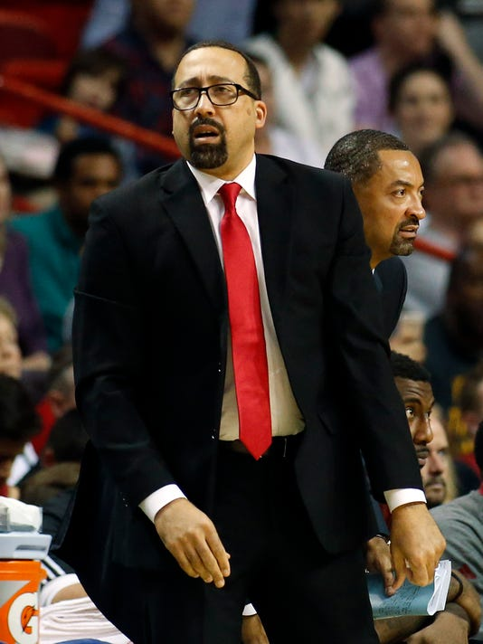 In this Dec. 25, 2015 photo, Miami Heat assistant coach David Fizdale looks on during second half action of an NBA basketball game against the New Orleans Pelicans in Miami. The Memphis Grizzlies have hired Fizdale as their new coach and will introduce him in Memphis at a news conference Tuesday, May 31, 2016. (AP Photo/Joel Auerbach)