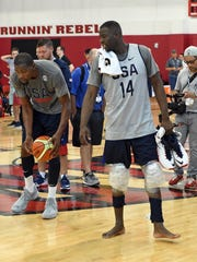 USA basketball player Draymond Green, right, stands beside new NBA teammate Kevin Durant before a practice in Las Vegas.