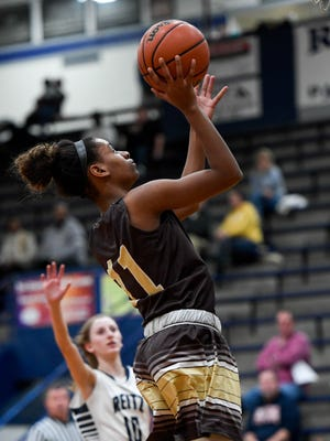 Central's Errin Hodges shoots a jump shot in front of Reitz's Carlie Hobbs as the Central High School Bears play the Reitz High Panthers at Reitz High School Thursday, December 15, 2016.