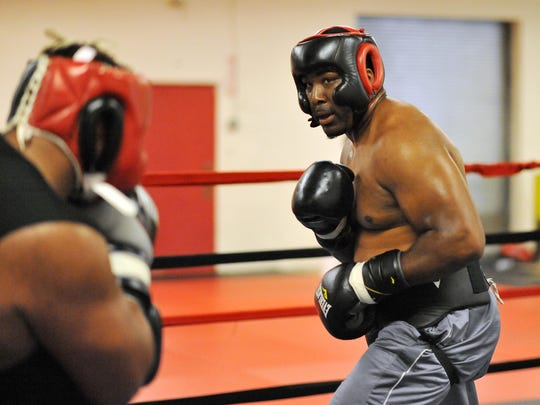 Quian Davis , who is 34-year-old Buena HS graduate is preparing for his first pro boxing match soon.  He trains at Vendetta Boxing in Vineland.  July 24, 2015.  Staff photo/Craig Matthews
