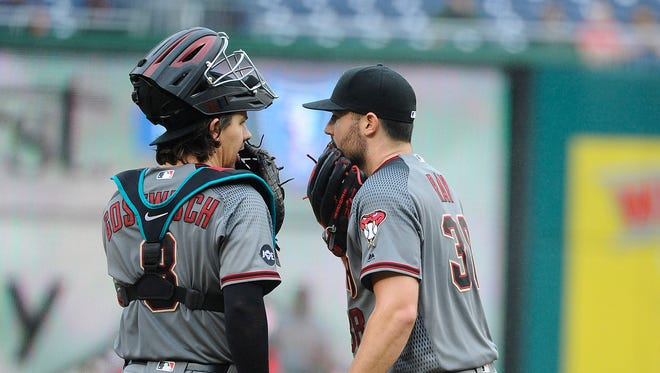 Arizona Diamondbacks starting pitcher Robbie Ray (38) talks with catcher Tuffy Gosewisch (8) during the fourth inning against the Washington Nationals at Nationals Park.