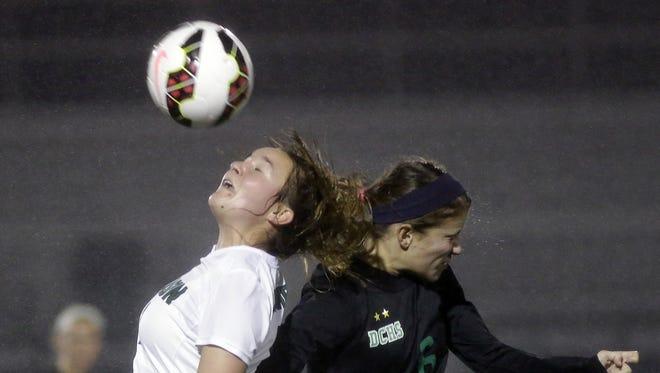 Mason's  Haley Moses battles Dublin Coffman's Hannah   Lehmkuhl for the ball.