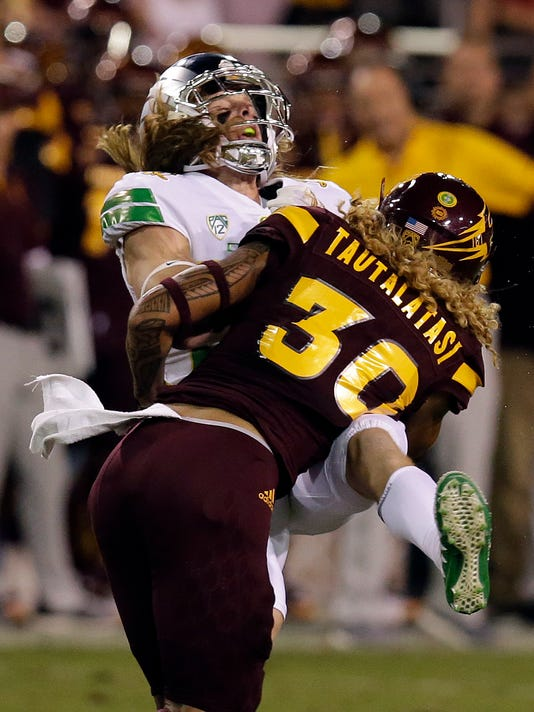 Arizona State defensive back Dasmond Tautalatasi (30) hits Oregon wide receiver Kyle Buckner during the first half of an NCAA college football game, Saturday, Sept. 23, 2017, in Tempe, Ariz. (AP Photo/Rick Scuteri)