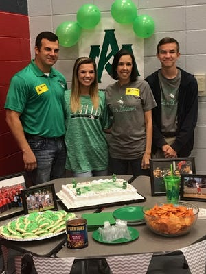 North DeSoto's Sydney Webster, second from left, poses with her dad, Darrell, mother, Alicia, and brother, Everett, after signing scholarship papers with Arkansas-Monticello Wednesday morning.