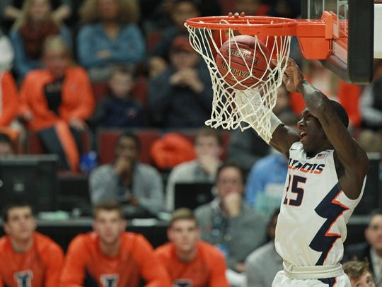 Illinois guard Kendrick Nunn dunks against Michigan in the 2015 Big Ten tournament.