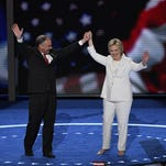 Hillary Clinton and Tim Kaine acknowledge the audience after Clinton spoke during the 2016 Democratic National Convention.