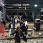 Passengers rush to safety after a N.J. Transit train crashed in to the platform at the Hoboken Terminal.