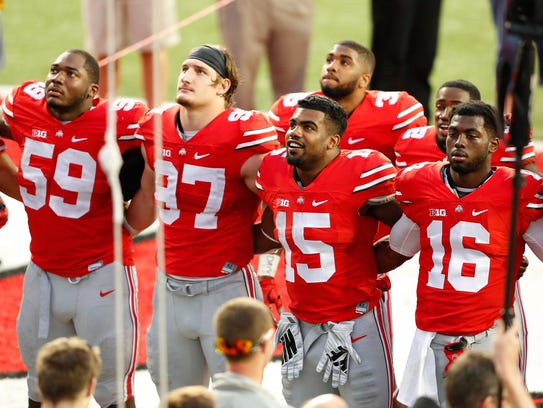 Tyquan Lewis (59) and J.T. Barrett (16) are remaining