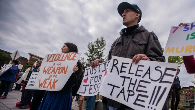 Right, Chris Sordiff, 29, of Williston -- a life-time friend of Jesse Beshaw who was shot and killed by Franklin County Sheriff Officer Nicholas Palmier last week in Winooski, protests against what he called a blatant effort by the officer to kill his friend rather than apprehend him.