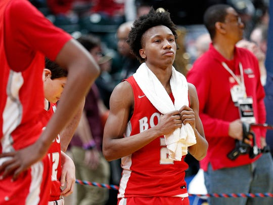 A dejected Evansville Bosse Bulldogs Mekhi Lairy (2) following their IHSAA 3A boys basketball state finals game at Bankers Life Fieldhouse on Saturday, March 24, 2018. TheCulver Academies Eagles defeated the Evansville Bosse Bulldogs 64-49.