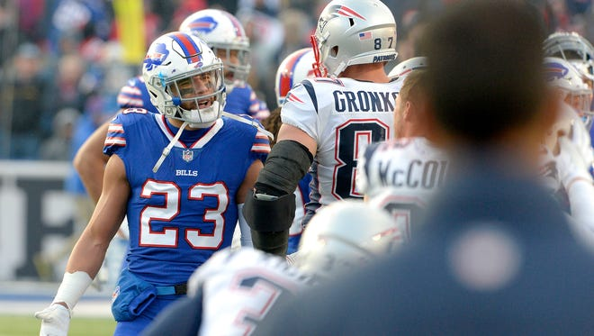 Buffalo Bills strong safety Micah Hyde (23) argues with New England Patriots tight end Rob Gronkowski (87) during their game Dec. 3, 2017, in Orchard Park, N.Y.