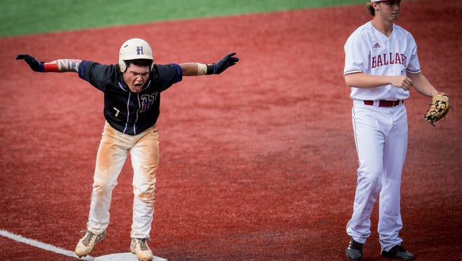 Male Bulldogs Tristin Garcia (7) celebrates after a 2 RBO triple during the Seventh Region baseball tournament semifinals game 1 against the Ballard Bruins at Jim Patterson Stadium in Louisville, Kentucky, Tuesday, May 29, 2018.