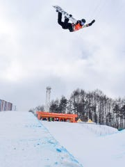 Canada's Derek Livingston soars during halfpipe competition