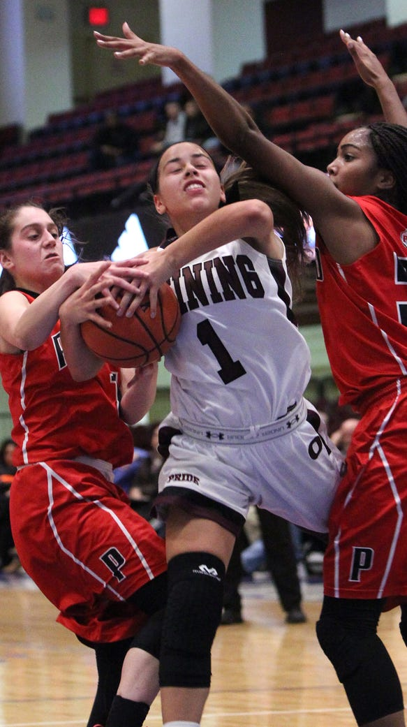 Ossining's Jaida Strippoli is pressured by Penfield's