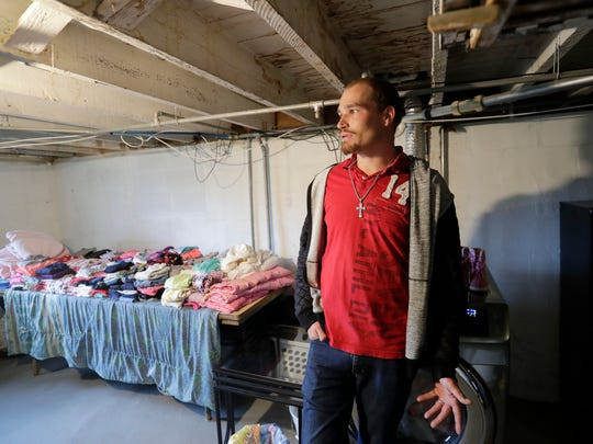 Branden Neidl of Green Bay talks in his basement Thursday, October 26, 2017 about ongoing issues with the rental house he occupies with his wife and three children in Green Bay, Wis.