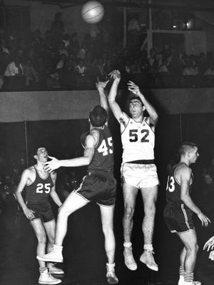 Marion Pierce scores two of the 3,019 points he racked up in four years at Lewisville — nearly 1,000 more than anyone else in Indiana history had scored when he was done in 1961. His record stood until 1990, when Bedford North Lawrence's Damon Bailey finished with 3,134 points.