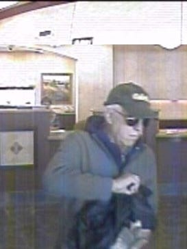 A photo showing the alleged bank robber wearing a green Cabela's hat robbing the First Independent Bank on Monday in north Reno.