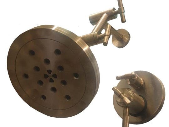 A new take on brass is being shown in lighting, plumbing and hardware, while finishes range from brushed to polished.