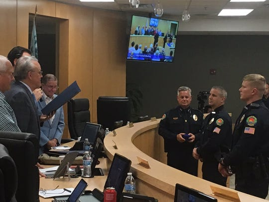 "The Marco Island City Council recognizes police officers Willem Hernandez and Jeffrey Stafford for ""taking extraordinary and heroic rescue measures to save an individual's life"" at its meeting on March 5, 2018."
