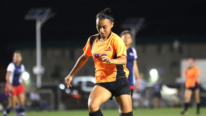 In this file photo, Skyylerblu Johnson, playing for the Personal Finance Center Lady Crushers, takes the ball to the goal against Quality Distributors during a Week 7 match of the 2016 Bud Light Women's Soccer League Spring season. Johnson was named MVP of the 2016 IIAAG Girls' Soccer League on Wednesday.
