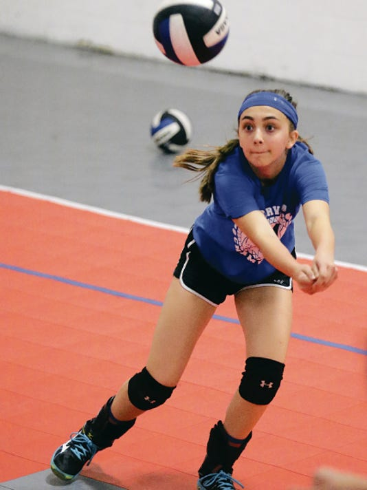 Nadia Kern, 13, an outside hitter for the 915 United 14U team, works on her digging at practice as the team prepares for the upcoming 2015 USA Volleyball Girls Junior National Champioship Tournament on June 23 - July 2  in New Orelans.
