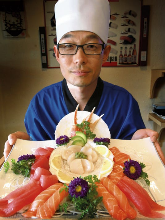 Chef Chopstick shows off his amazing, creative scallop dish at Riyoma Japanese Restaurant.