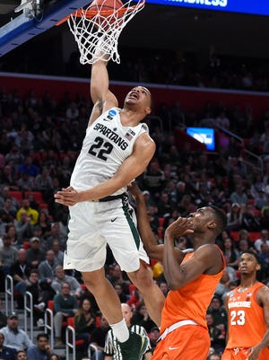 Michigan State's Miles Bridges dunks during the second half on Sunday, March 18, 2018, at the Little Caesars Arena in Detroit. Syracuse beat Michigan State 55-53.