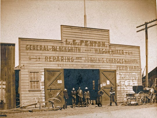 This photo shows the L. E. Fenton Blacksmithing Shop,