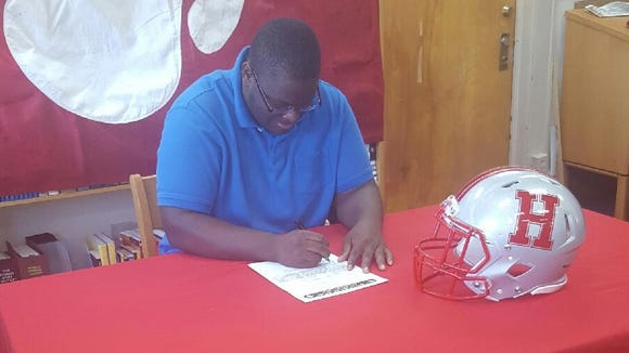 Hendersonville senior Blaine Sharpe has signed to play college football for Mars Hill.