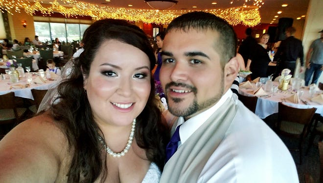 """A cellphone """"selfie"""" shows Cara and Jonathan Urias at their wedding on Aug. 6 at the San Juan Country Club. Pictures of the event taken by professional photographer Shanice Gonzales were stolen."""