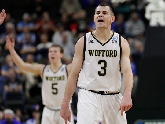 Wofford's Fletcher Magee (3) celebrates a 3-point shot against Seton Hall with teammate Storm Murphy (5) during the second half of a first-round game in the NCAA men's college basketball tournament in Jacksonville, Fla., Thursday, March 21, 2019. (AP Photo/John Raoux)