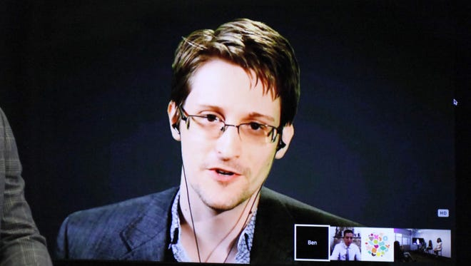 """Edward Snowden as he delivers remarks via video link from Moscow to attendees at a discussion regarding an International Treaty on the """"Right to Privacy, Protection Against Improper Surveillance and Protection of Whistleblowers"""" in Manhattan, September 24, 2015 in New York."""
