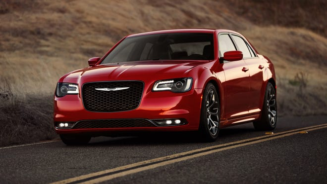 Chrysler updated its big 300 sedan for 2015 with bigger grille, bolder style and menu of options including mobile Internet link.
