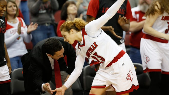 Louisville's Briahanna Jackson is congratulated as she left the game after leading her team back to beat IUPUI. Dec. 13, 2015.