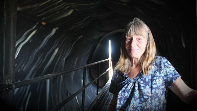 Debbie Morse, owner and operator of Horror Hall, stands in front of the new spinning tunnel attraction. Horror Hall will open on Saturday for Harvest Fest, giving the public its first glimpse at the newest addition to Horror Hall. Officially, Horror Hall will open on Oct. 7.