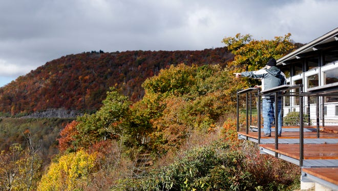 People view the fall color from the Pisgah Inn along the Blue Ridge Parkway October 22, 2016.
