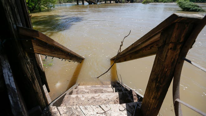Floodwaters from the Jacks Fork River cover the stairs that lead to a patio at the River's Edge Resort in Eminence, MO on Friday, May 5, 2017.