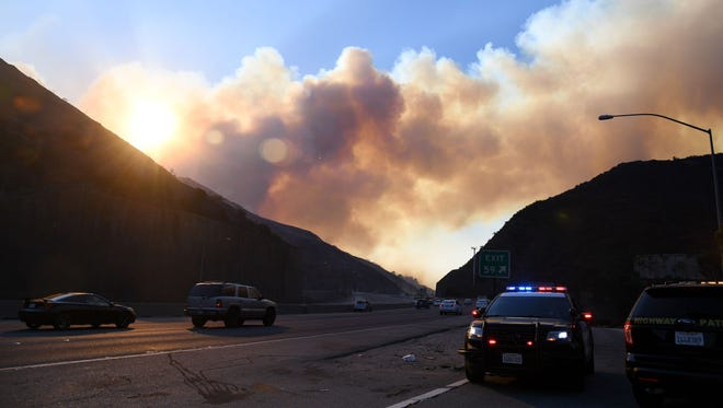 Smoke from the Skirball Fire rises above the 405 freeway.