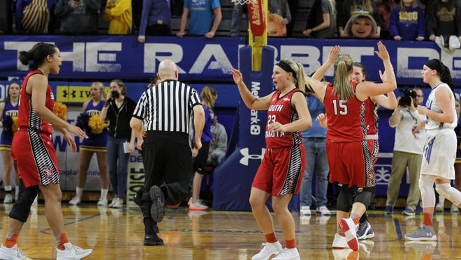South Dakota's Madison McKeever (23) looks to celebrate with teamates after the Coyotes' 67-61 victory over the Jackrabbits Thursday night at Frost Arena in Brookings.