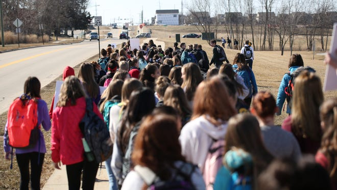 North Central Junior High students in Iowa walk out of class during a March 2 protest. Students in several local schools districts plan to do the same Wednesday.