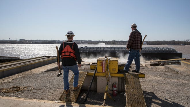 Bill Seymour, left, watched after launching a chemical barge at Jeffboat. Seymour is with Florida Marine Transport LLC., who will take possession of the barge. On right is Jeffboat worker Jeff Hagan who was there in case Seymnour's axe didn't cut the rope. This is the last chemical, or tanker barge ever built at Jeffboat. April 12, 2018.