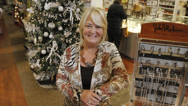Mary Lou Chalmers is seen inside her Glue Factory Gift Shop in Chili in 2013.