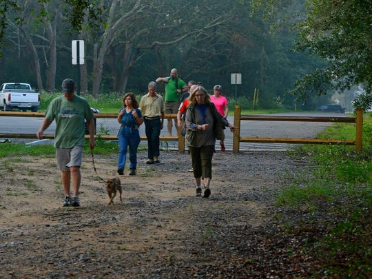 Western Gate Chapter of the Florida Trail Association members start their walk through the Jones Swamp Nature Preserve Sunday morning.