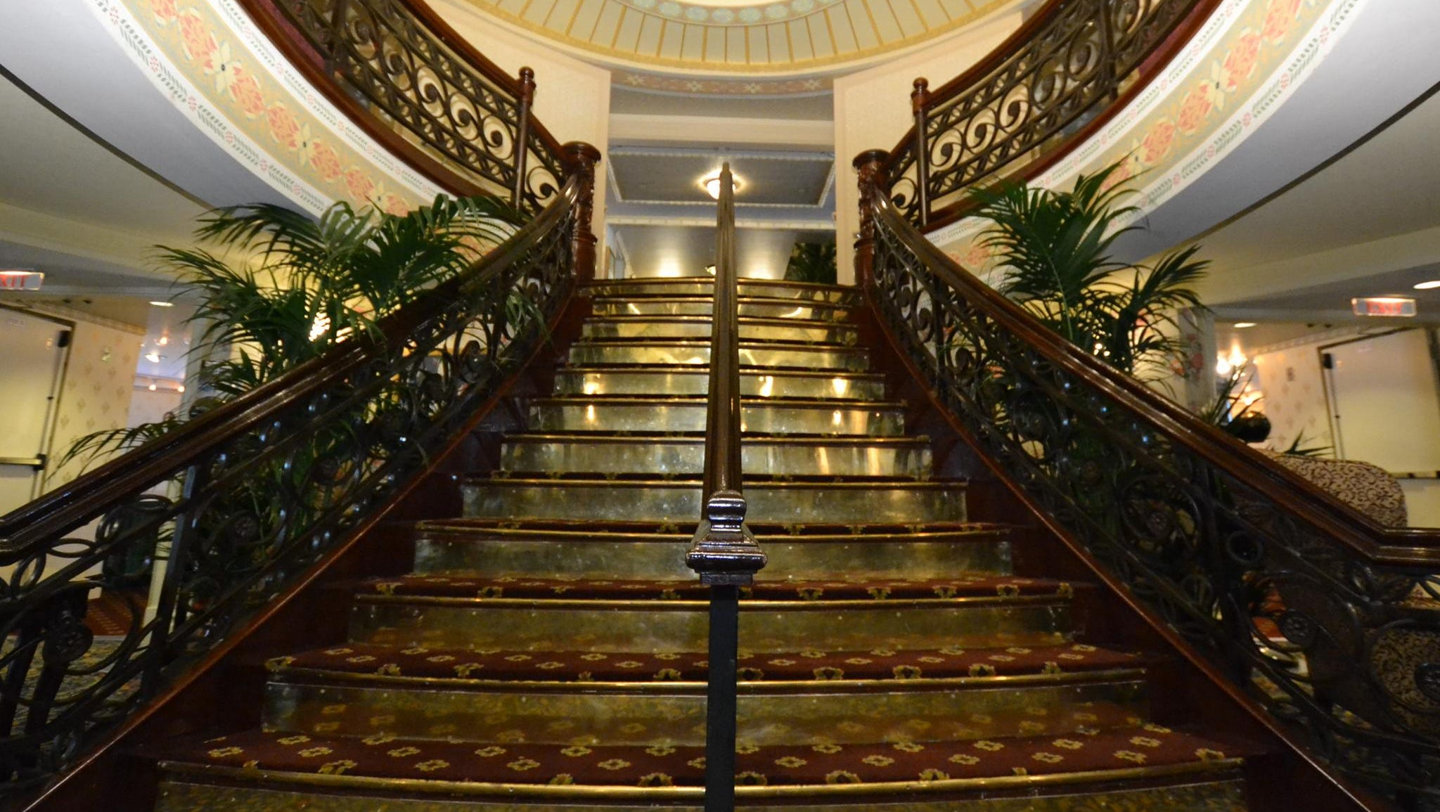 A grand staircase rises from the Lounge to the American Queen's Purser's Lobby.