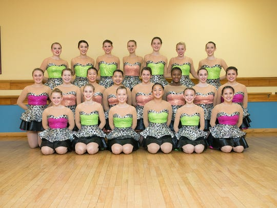 The 23 dancers from the Armstrong School of Dance heading